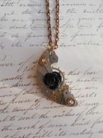 Steampunk necklace with black rose and gears by SteamJo