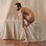 Nude Male Stock Standing leg to chest, profile by TheMaleNudeStock