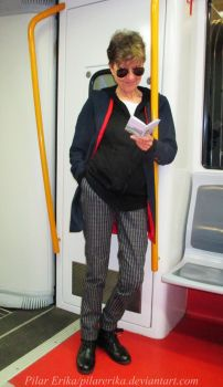 12th Doctor reading on the underground by PilarErika