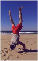 Handstand in the Sand of Lissabon by TheArgon
