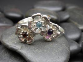 Stackable flower rings by nellyvansee