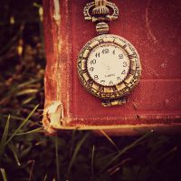 Vintage book and pocket watch by angela-swift