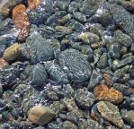 Pebbles Through  Water by BlonderMoment
