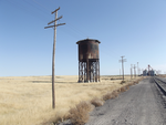 Weathered Poles and Water Tank by Mellette