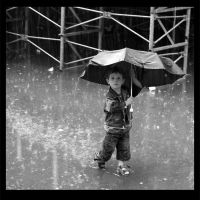boy in rain by dieuwertjebax