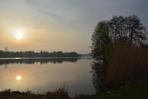 Foggy and cold Sunset over lake by LuDa-Stock
