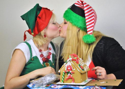 Christmas Elf Kisses with Gingerbread House by Vpoolephotos