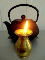 Tea pot and candle by Maleiva