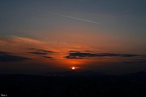 Sun saying goodnight to the city by ginavd