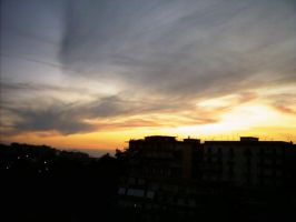 Sunset on the city.. by Isyde