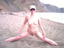 streching on a sand by inaturist