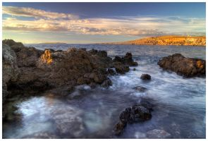 Sun on Cap Cavalleria by Climbotizzo