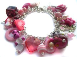Pink charm bracelet 3 by fairy-cakes