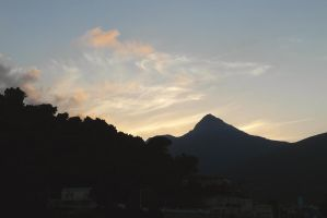 Mt Sidi Achour with sunset clouds by yuushi01