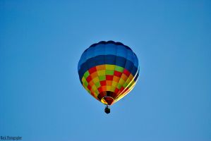 A hot-air baloon in the sky. by Mark-Photographer