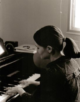 Amber at the Piano by Red-Isabell