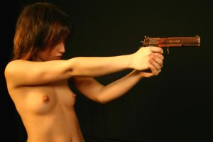 E - Topless with Gun by 11001001