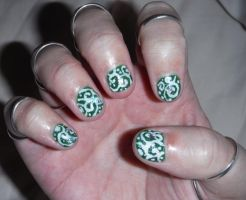 Green with white swirl nail art by Amazinadrielle