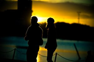 silhouettes at sunset by thehomeboy
