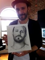 Greg Laswell holding his Drawing by Doctor-Pencil