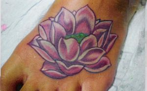 lotus tattoo by lilmrsfrankenstein