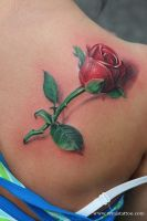 Rose tattoo by Remistattoo