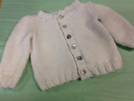 hand knit baby cardigan by ravnsdaughter