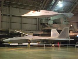F-22A with Boeing Bird of Prey by fighterace2688