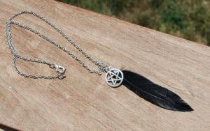 Feather Pentagram Necklace by kittykat01