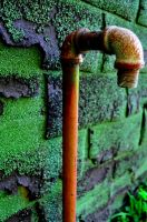 Rusted Pipe Green Background by PAlisauskas