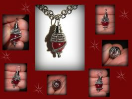 A tiny wire wrapped red ruby pendant / charm by marsvar