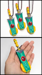 Transistor Sword Charm Necklace by WINGEDLESS
