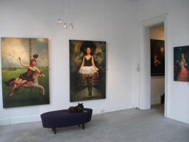 Paintings are hung in the gallery by graemeb