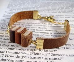Miniature Book Stack Bracelet by JanDaJewelry