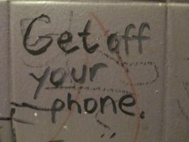 Get Off Your Phone - bathroom graffiti by Bauvy