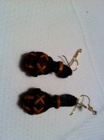 Severed head earrings. by MaskedRascal