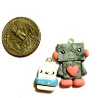 Polymer clay robot and milk necklace charms by Ysab3lla