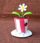 Tiny Top Hat: Solar Flower Power by TinyTopHats