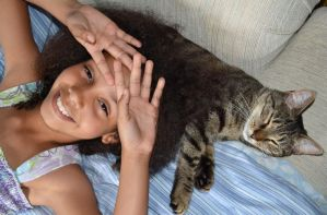 A kid and her cat by asharceneaux