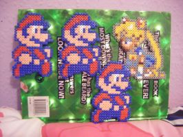 Busy with Perler beads by Llama-lady