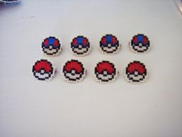 Pokeball pins by HopperARTZ