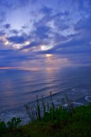 Dawn breaks through rainclouds by danika79