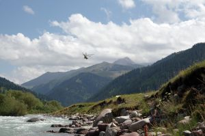 Mountain landscape with helicopter by voldemometr