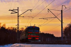 suburban train at sunset by Lyutik966
