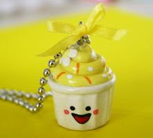 Happy face yellow cupcake necklace by jbphillips