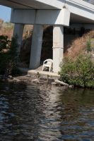 chair on river bank by MLeighS