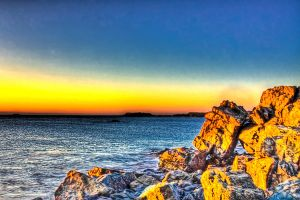 Sunset shines on the rocks HDR by Witch-Dr-Tim