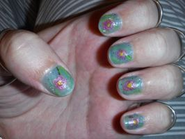 Blue with pink flowers nails by Amazinadrielle