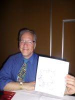 Tony at Crypticon holding Quick Drawing II by Poorartman