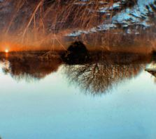 Reflection of a sunset by Juliemarie91